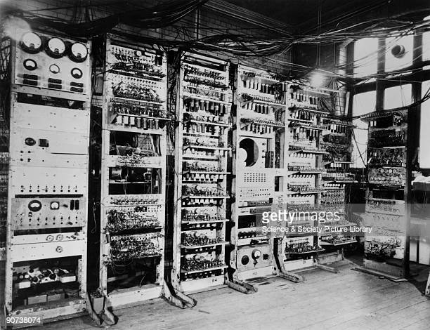 This contemporary photograph shows the first fully electronic storedprogram computer in operation It was built at Manchester University under the...