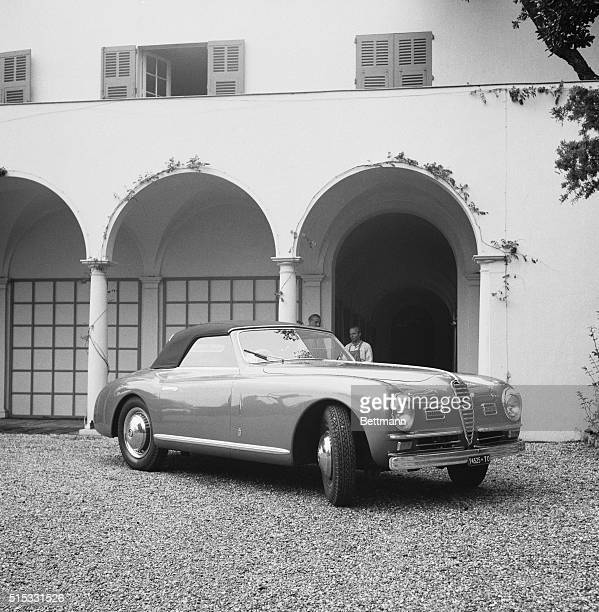 This convertible AlfaRomeo touring car is the wedding gift of Prince Aly Khan to his future wife screen star Rita Hayworth It is battleship gray with...