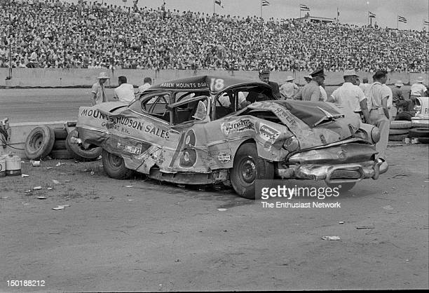 This crumpled heap was once a 1954 Hudson Hornet Driver Arden Mounts of Mounts Hudson Sales crashed hard into Don Duckworth's 1955 Chevrolet after it...