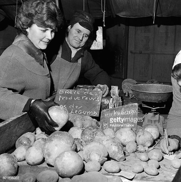 This Customer Notes The Vegetables Scarcity On This Paris Market Due To The Strike Of Producers And The Intense Cold in Paris France on February 01...