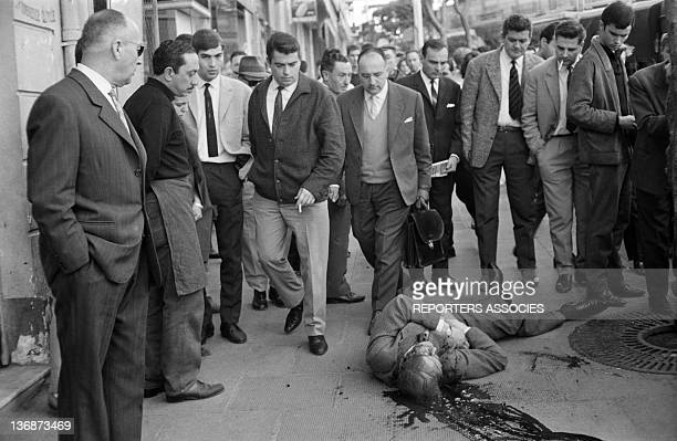 This dead body victim of the wave of attacks perpetrated by the OAS lies on the sidewalk on April 11 1962 in Algiers Algeria On the eve of the Evian...