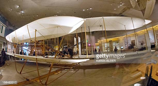 This December 15 2012 photo shows the original 1903 Wright Flyer centerpiece of 'The Wright Brothers The Invention of the Aerial Age' exhibition at...