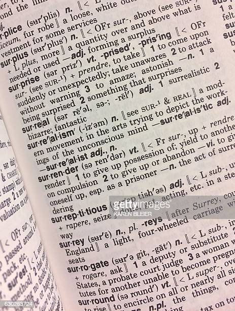 This December 16 2016 photo illustration taken in Washington DC shows the definition for the word Surreal in a copy of the Webster's Desktop...