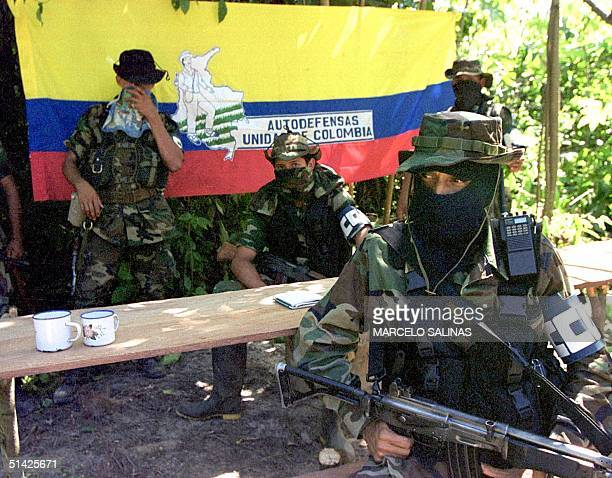 This December 1999 file photo shows Colombian paramilitary commandant Camilo in an emcampment in La Gabarra with his personal security guards En esta...