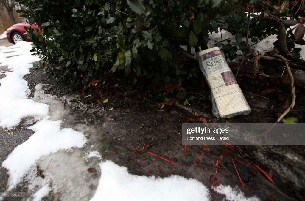 This December 24, 2017 Sunday edition of the Journal Tribune is under a bush in front of a home at the corner of Pool and Pike Streets.