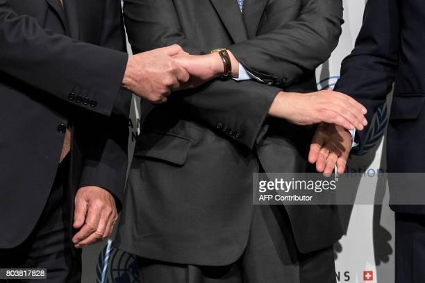 This detail shows Greek Cypriot President Nicos Anastasiades UN Secretary General Antonio Guterres and Turkish Cypriot Leader Mustafa Akinci shaking...