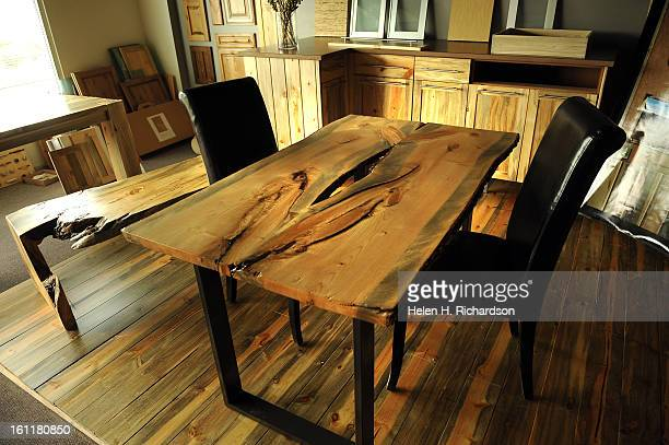 This dining room table, right, and coffee table, left as well as the kitchen cabinetry are all made of beetle kill wood. Corbin Clay designs and...