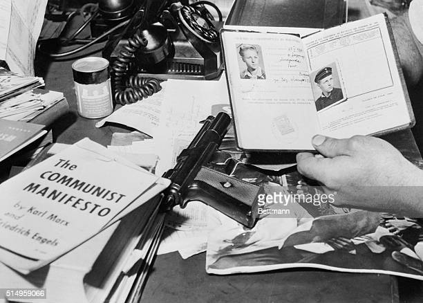 This display of Red Literature including the Communist Manifesto by Karl Marx a target pellet gun and Yugoslavian passport issued to James Petroff...