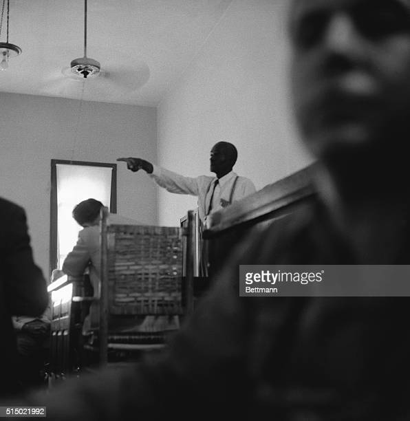 This dramatic courtroom scene shows 64yearold 'Uncle Mose' Wright GrandUncle of murdered Emmett Till 14yearold Negro boy as he stood up in the packed...