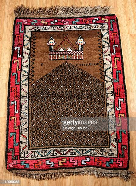 This early 1950's era Kurdish prayer rug from Eastern Turkey is displayed at Yoruk Rug Gallery in Chicago Illinois in November 2006