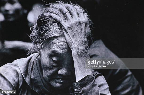This elderly Vietnamese peasant woman shows the misery of having war conducted around her home in Quang Ngai Province, one of the more embattled...