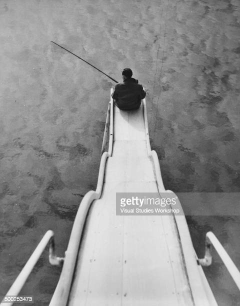 This enthusiastic fisherman found the tide out and overcame the problem by trying his luck in the bathing pool after sliding down the water slide to...