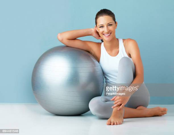 this exercise ball is part of every workout - fitness ball stock pictures, royalty-free photos & images