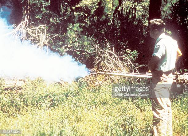 This field technician was using a swingfog handheld fog generator in an attempt to control populations of potential disease vectors by disseminating...
