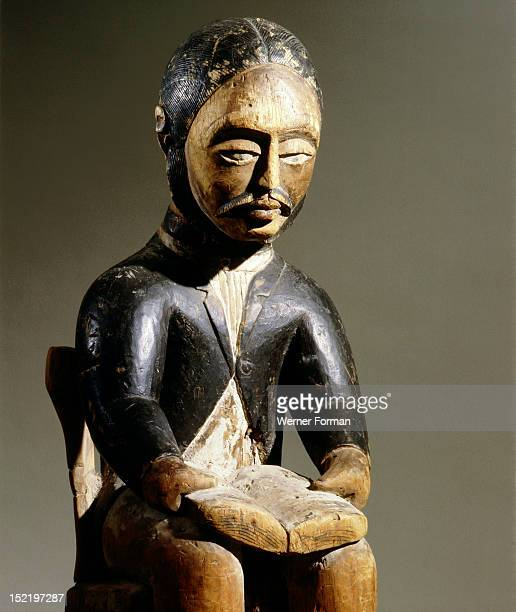 This figure of a man reading a book is believed to depict a Swedish or Swiss missionary Democratic Republic of Congo Kongo mid 19th c Western Congo