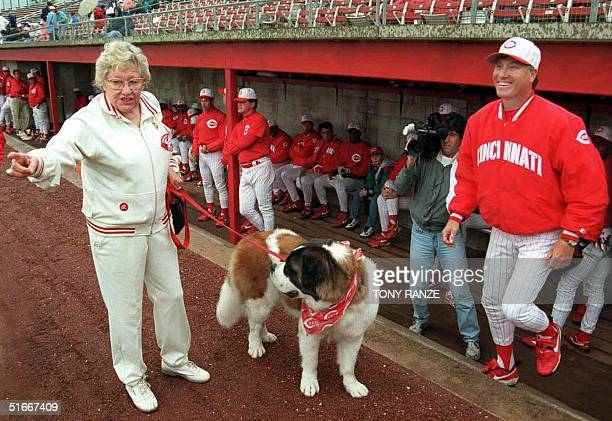 This file photo dated 01 March 1996 shows former Cincinnati Reds owner Marge Schott walking her St Bernard Schottzie as thenReds manager Ray Knight...