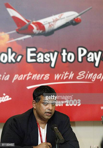 This file photo dated 01 October 2003 shows Tony Fernandes CEO of AirAsia speaking to reporters at a press conference after signing an agreement with...