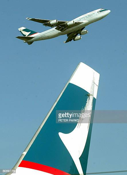 This file photo dated 04 July 2002 shows a Cathay Pacific airways Boeing 747 taking off from Hong Kong International Airport Hong Kong flag carrier...