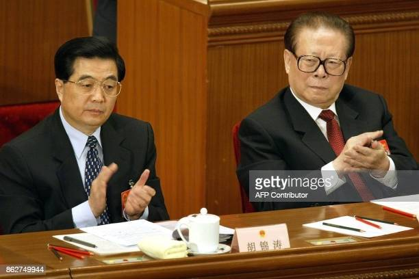 WITH 'CHINAYEAR' This file photo dated 05 March 2004 shows Chinese President Hu Jintao and military chief Jiang Zemin applauding as Premier Wen...