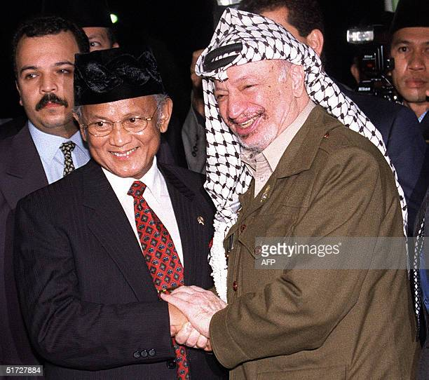 This file photo dated 08 April 1999 shows then Indonesian President BJ Habibie greeting Palestinian leader Yasser Arafat at Jakarta's Halim...