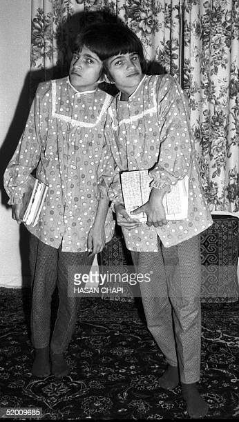This file photo dated 10 October 1989 shows Iranian sisters Laleh and Ladan Bijani posing for a picture at their adoptive father's house in Karaj...