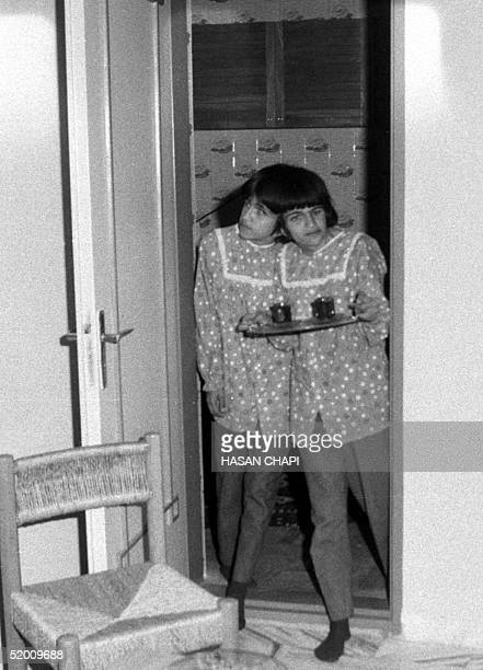 This file photo dated 10 October 1989 shows Iranian sisters Laleh and Ladan Bijani serve tea in their adoptive father's house in Karaj 46km from...