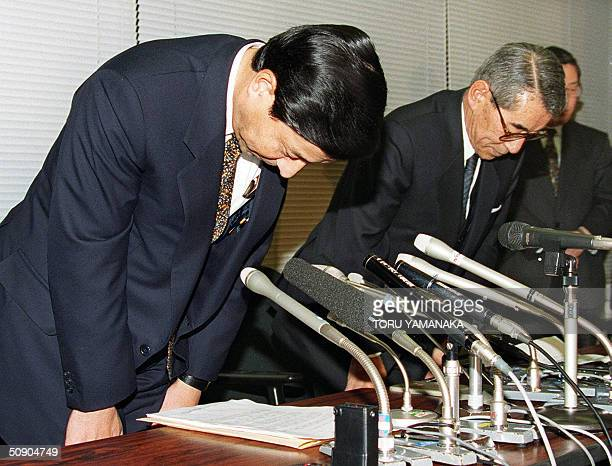 This file photo dated 13 December 1998 shows the thenpresident of Nippon Credit Bank Ltd Shigeoki Togo and vice president Tadao Iwaki bowing deeply...
