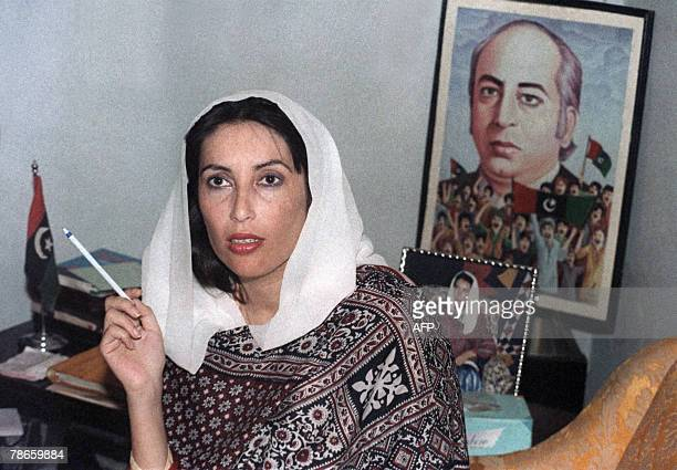 This file photo dated 17 November 1988 shows Pakistani People's Party leader Benazir Bhutto holds a press conference in front of a poster of her...