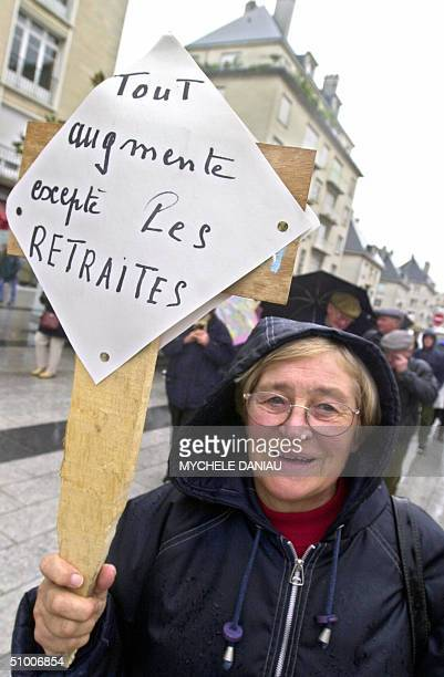 This file photo dated 20 October 2001 shows a retired peasant demonstrating in the northern city of Caen, for a raise of pension benefits. Europeans...