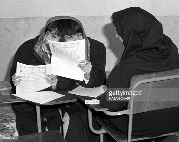 This file photo dated 23 April 1993 shows Iranian sisters Laleh and Ladan Bijani taking their university entrace examination in Tehran The historic...