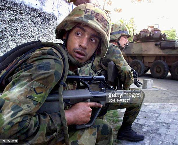 This file photo dated 24 September 1999 shows Australian troops conducting an operation to flush out militia in Dili According to Australian...