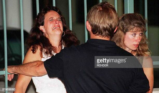 This file photo dated 27 July 1996 shows a woman crying after an explosion rocked Centennial Park in Atlanta The Federal Bureau of Investigation 31...