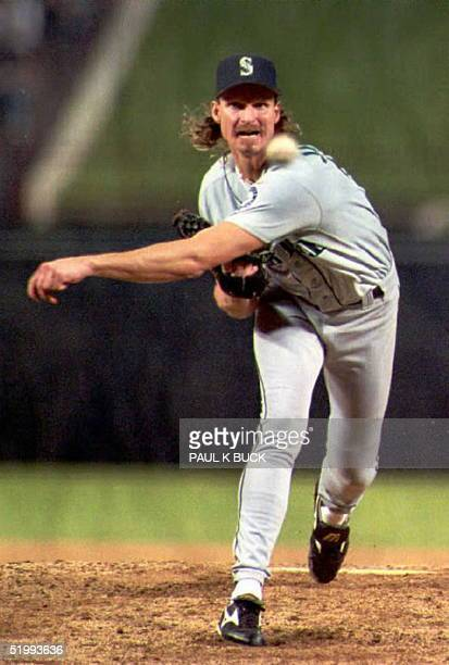 This file photo dated 28 September 1995 shows Seattle Mariners pitcher Randy Johnson pitching against the Texas Rangers in Arlington Texas Johnson...
