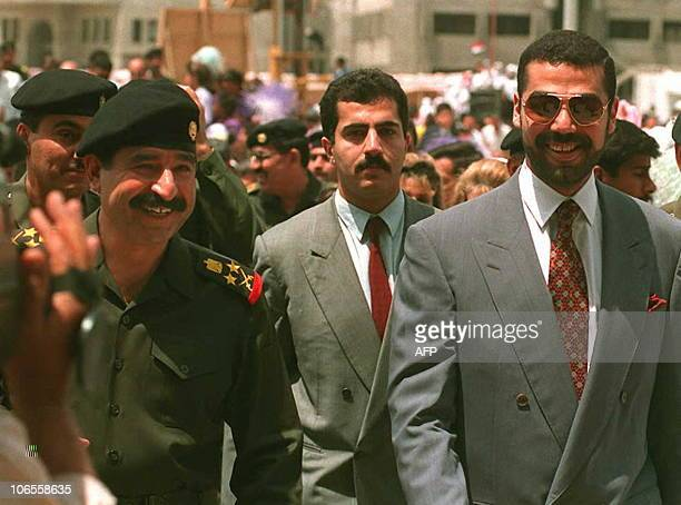 This file photo dated 30 April 1995 shows Iraqi President Saddam Hussein's soninlaw Gen Hussein Kamal Hassan Hussein's youngest son Qusay and his...