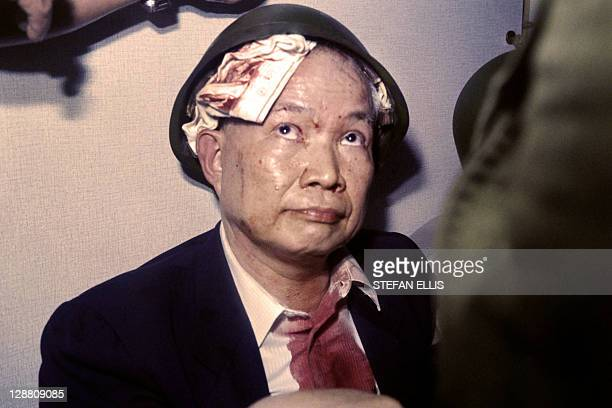 This file photo dated on November 27 1991 in Phnom Penh shows Khieu Samphan then leader of the Khmer Rouge wearing an army helmet and a pair of...
