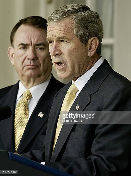 This file photo released 16 November 2004 shows US President George W Bush as he speaks to reporters in the Rose Garden at the White House in...