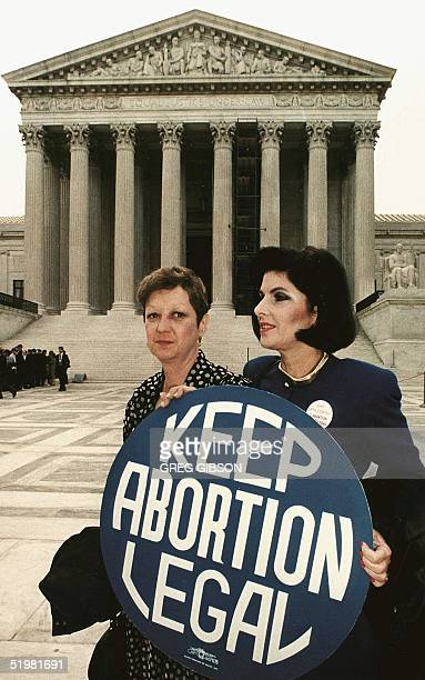 """This file photo shows Norma McCorvey formally known as """"Jane Roe"""",as she holds a pro-choice sign with former attorney Gloria Allred in front of the..."""