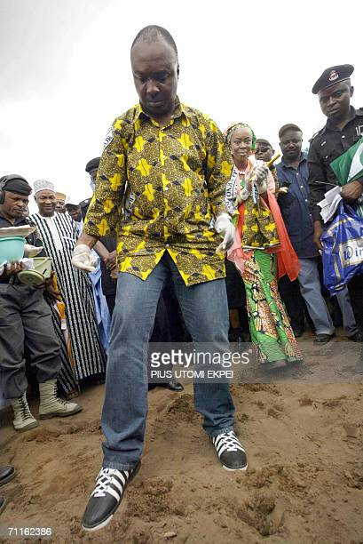 This file photo taken 08 July 2005 shows Kwara state governor Bukola Saraki watched by his wife Toyin as he plants seeds during the first planting of...