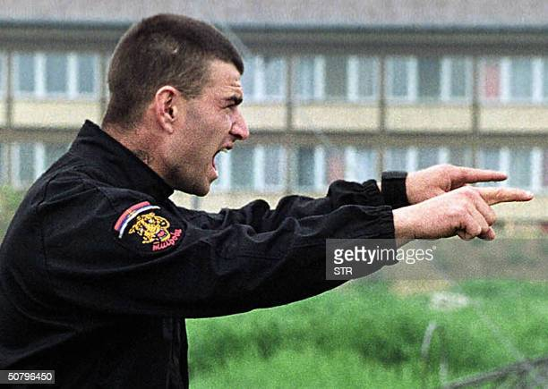 This file photo taken in 1995 shows shows Milorad Lukovic pictured in the Croatian town of Erdut during a military training of Zeljko RaznatovicArkan...