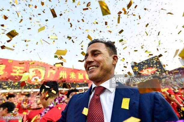 This file photo taken on December 1, 2019 shows Guangzhou Evergrande's head coach Fabio Cannavaro celebrating after his team defeated Shanghai...