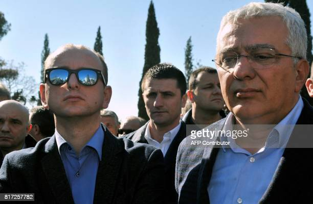 This file photo taken on February 15 2017 shows Montenegro's opposition leaders Andrija Mandic and Milan Knezevic attending a protest in front of the...
