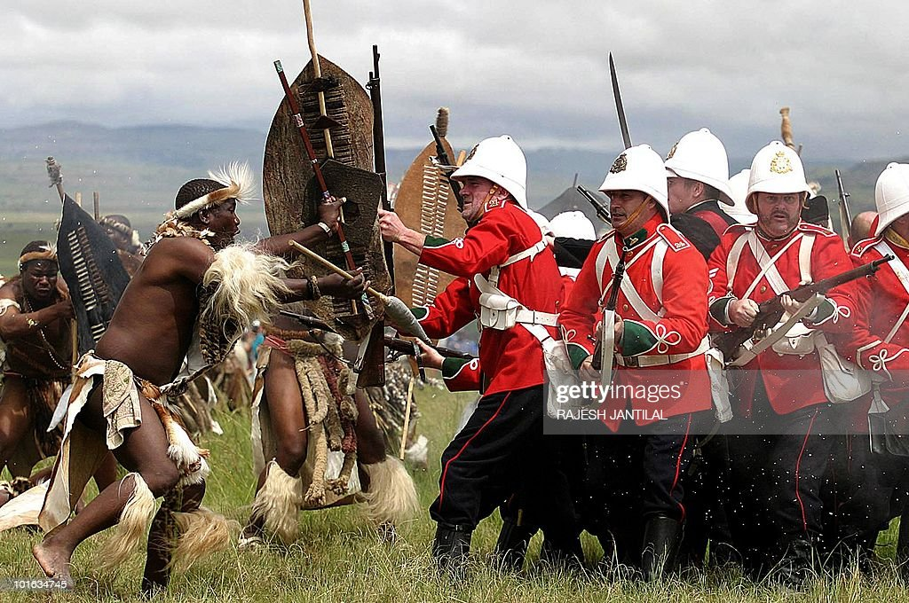 This file photo taken on January 24, 2004 of a group in British uniforms assailed by Zulu warriors during the 125th anniversary re-enactment of the battle of Isandlwana some 350 kilometres north of Durban. Anglo-Zulu battlefields and Shaka's grave and birthplace now anchor a tourism trade in eastern KwaZulu-Natal province that aims to give foreigners a slice of history and rural South African life. Spear-wielding warriors pour over the hilltops to attack a startled red-coat army, in a battlefield re-enactment that hopes to lure World Cup fans away from the stadiums between matches.