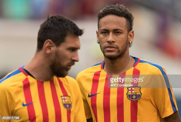 This file photo taken on July 22 2017 shows Neymar and Lionel Messi of FC Barcelona warming up before the International Champions Cup match between...