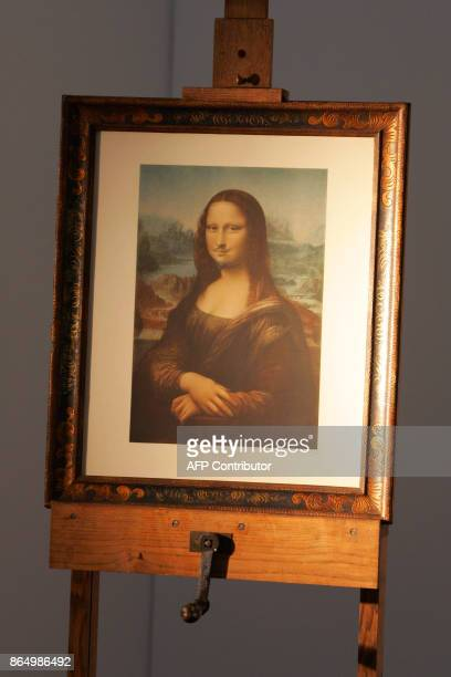 This file photo taken on June 2 2005 shows LHOOQ a moustachioed Mona Lisa by dadaist painter Marcel Duchamp painted in 1930 displayed at the Centre...