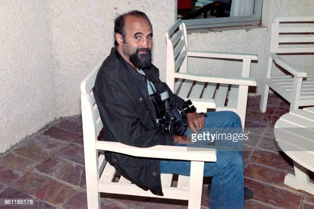 This file photo taken on June 9 1988 in Algiers shows Iranian photojournalist and Magnum photographer Abbas Attar known as Abbas during the 15th Arab...
