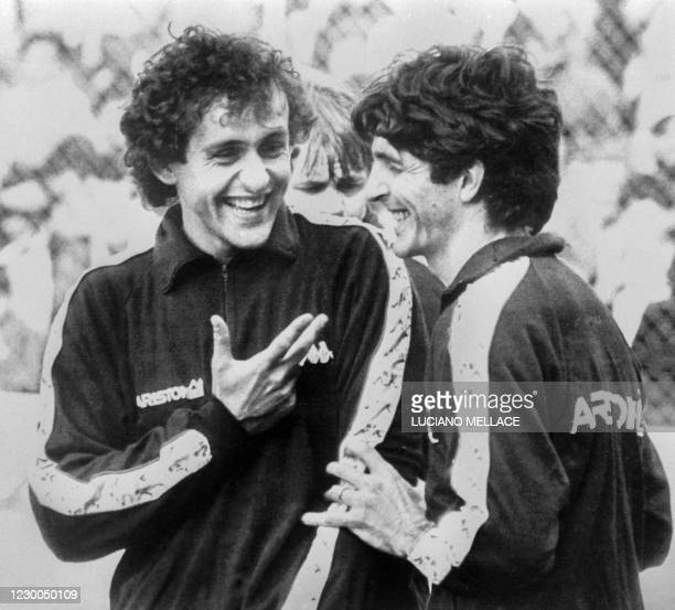 This file photo taken on May 15, 1984 shows Juventus' French forward Michel Platini laughing with Juventus' Italian forward Paolo Rossi during a...