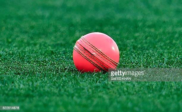This file photo taken on November 26 2015 shows a pink cricket ball on the Adelaide Oval ground ahead of the first daynight cricket Test match...