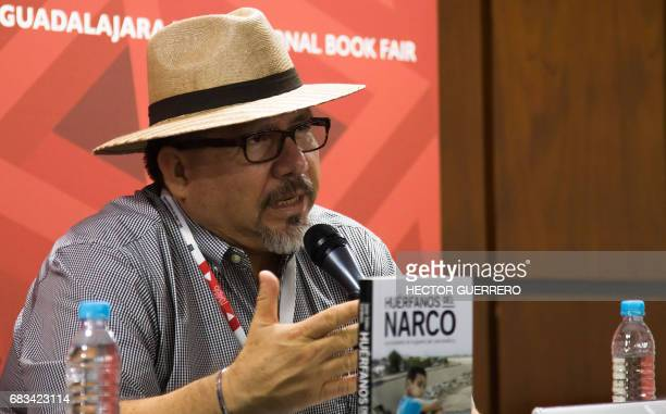 This file photo taken on November 27 2016 shows Mexican journalist Javier Valdez speaking during the presentation of his book 'Huerfanos del Narco'...