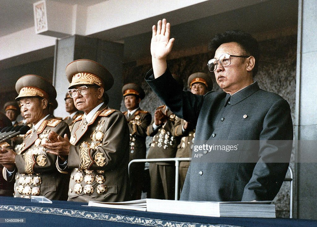 This file photo taken on October 10, 1995 shows North Korean leader Kim Jong-Il (R) waving at a military parade to celebrate the 50th anniversary of the founding of the Workers' Party of Korea (WPK). North Korean leader Kim Jong-Il has suffered a minor stroke but his life is not in danger, a South Korean government official said on September 10, 2008. Kim Jong-Il has never publicly nominated a successor, raising the possibility of instability in the impoverished nuclear-armed nation when he dies. RESTRICTED