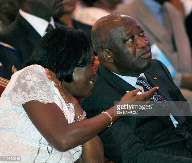 This file photo taken on October 9 2010 shows Ivorian president Laurent Gbagbo and his wife Simone Gbagbo in a hotel in Abidjan for Gbagbo's...